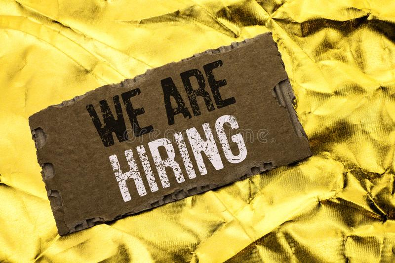 Writing note showing We Are Hiring. Business photo showcasing T. Alent Hunting Job Position Wanted Workforce HR Recruitment written tear Cardboard Piece the royalty free stock photography