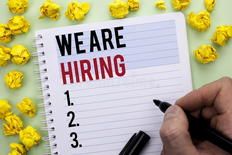 Writing note showing We Are Hiring. Business photo showcasing Talent Hunting Job Position Wanted Workforce HR Recruitment written. By Man Holding Marker stock images