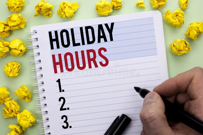 Writing note showing Holiday Hours. Business photo showcasing Celebration Time Seasonal Midnight Sales Extra-Time Opening written. By Man Holding Marker stock photos