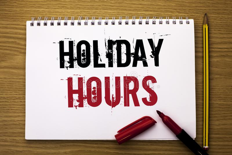 Writing note showing Holiday Hours. Business photo showcasing Celebration Time Seasonal Midnight Sales Extra-Time Opening written. Notebook Book the wooden royalty free stock photography