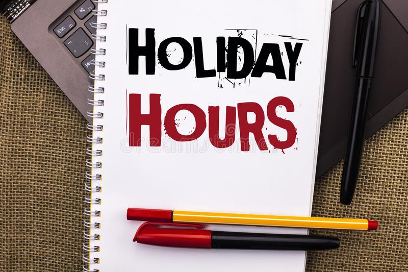 Writing note showing Holiday Hours. Business photo showcasing Celebration Time Seasonal Midnight Sales Extra-Time Opening written. Notebook Book placed Laptop royalty free stock photos