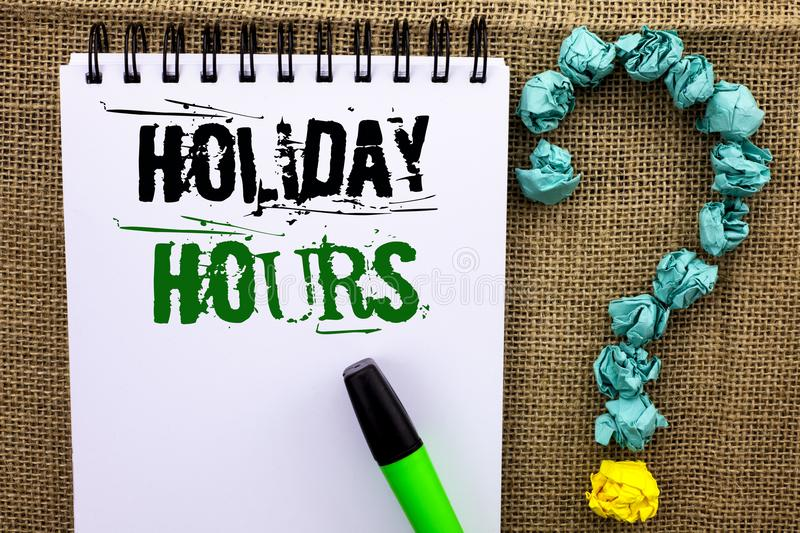 Writing note showing Holiday Hours. Business photo showcasing Celebration Time Seasonal Midnight Sales Extra-Time Opening written. Notebook Book the jute royalty free stock image
