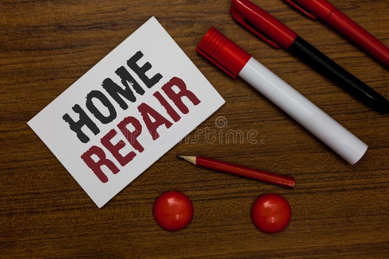 Writing note showing Home Repair. Business photo showcasing maintenance or improving your own house by yourself using tools White. Paper markers wooden royalty free stock photo