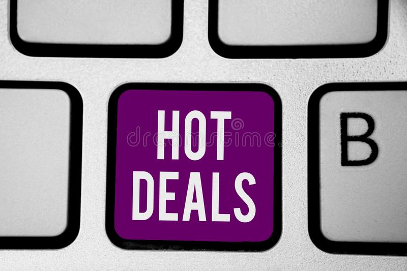 Writing note showing Hot Deals. Business photo showcasing An agreement through which one of the paties is offered and accept Keybo. Ard purple key Intention stock images