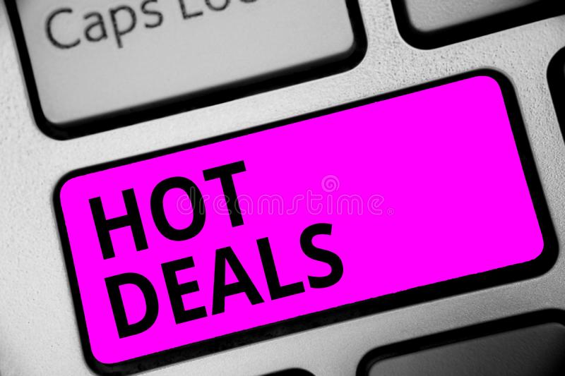 Writing note showing Hot Deals. Business photo showcasing An agreement through which one of the paties is offered and accept Keybo. Ard purple key Intention stock photo