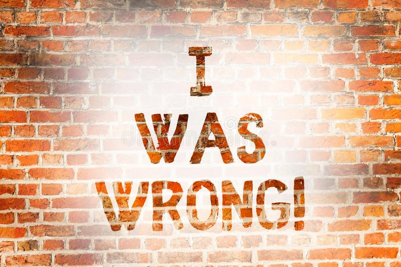 Writing note showing I Was Wrong. Business photo showcasing Acceptance of a mistake error Giving an apology Failure. Brick Wall art like Graffiti motivational royalty free stock photos