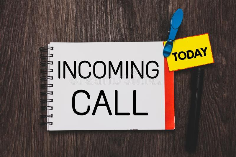 Writing note showing Incoming Call. Business photo showcasing Inbound Received Caller ID Telephone Voicemail Vidcall Open notebook. White page clothespin royalty free stock photography