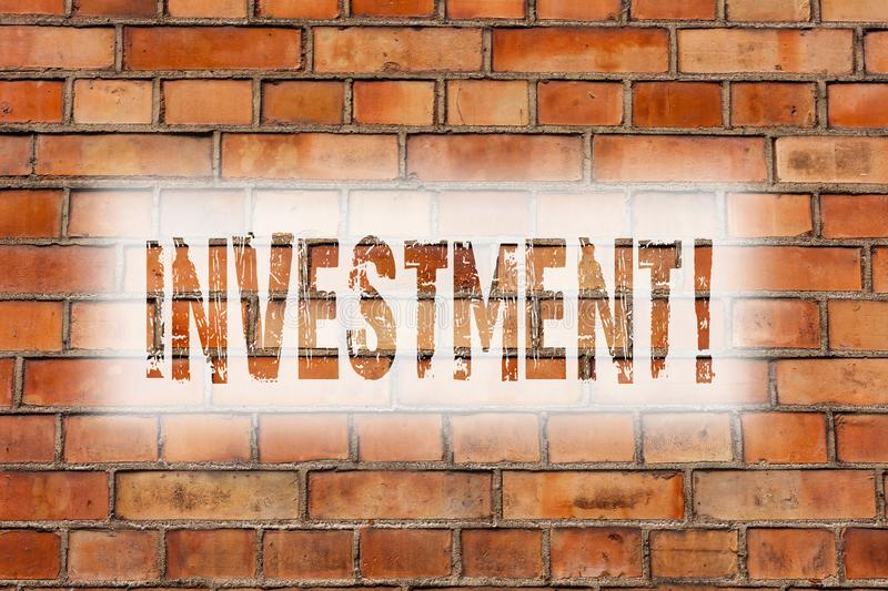 Writing note showing Investment. Business photo showcasing To put Money Time into something to make profit Brick Wall art like. Graffiti motivational call royalty free stock image