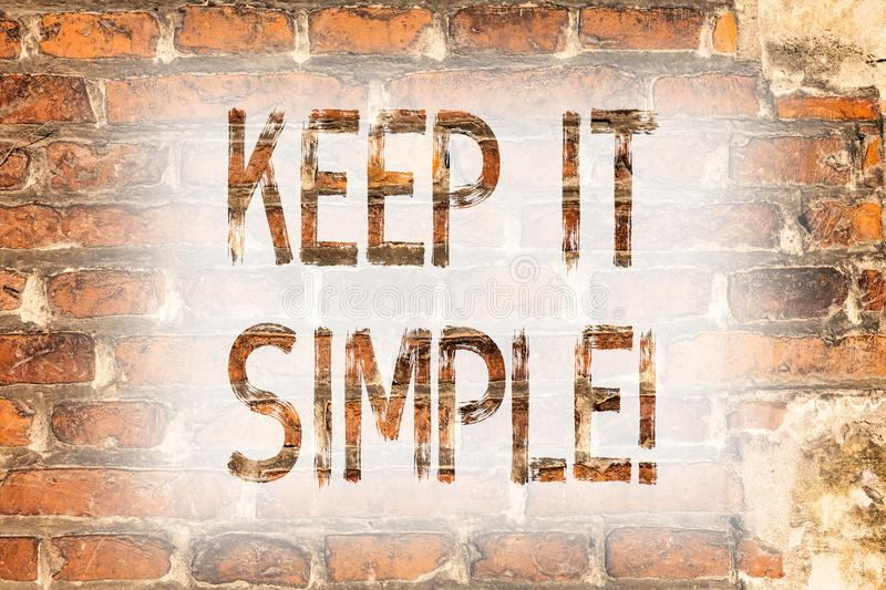 Writing note showing Keep It Simple. Business photo showcasing Simplify Things Easy Understandable Clear Concise Ideas Brick Wall. Art like Graffiti stock photo