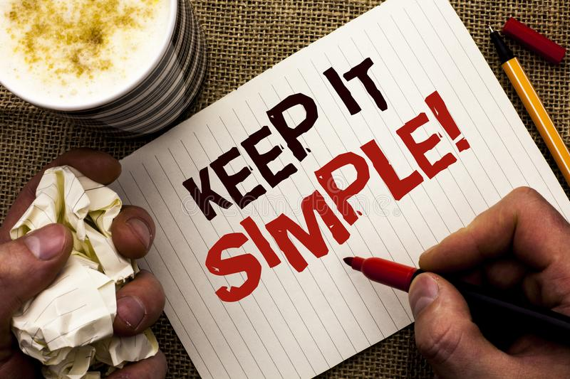 Writing note showing Keep It Simple Motivational Call. Business photo showcasing Simplify Things Easy Clear Concise Ideas written. By Man Holding Marker royalty free stock photo