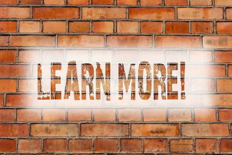 Writing note showing Learn More. Business photo showcasing Study harder Develop new skills abilities Get extra education Brick. Wall art like Graffiti royalty free stock photos