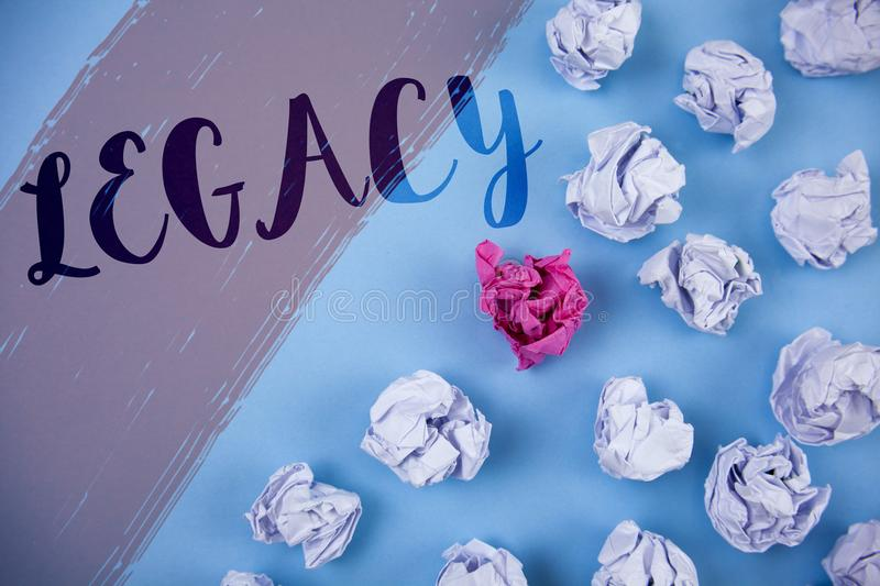 Writing note showing Legacy. Business photo showcasing Transmitted Received from an ancestor Money Properties given by will writt. En Painted background Crumpled royalty free stock images