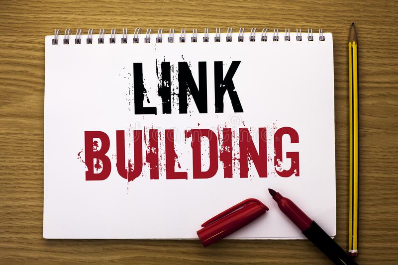 Writing note showing Link Building. Business photo showcasing Process of acquiring hyperlinks from other websites Connection writ. Ten Notebook Book the wooden royalty free stock images