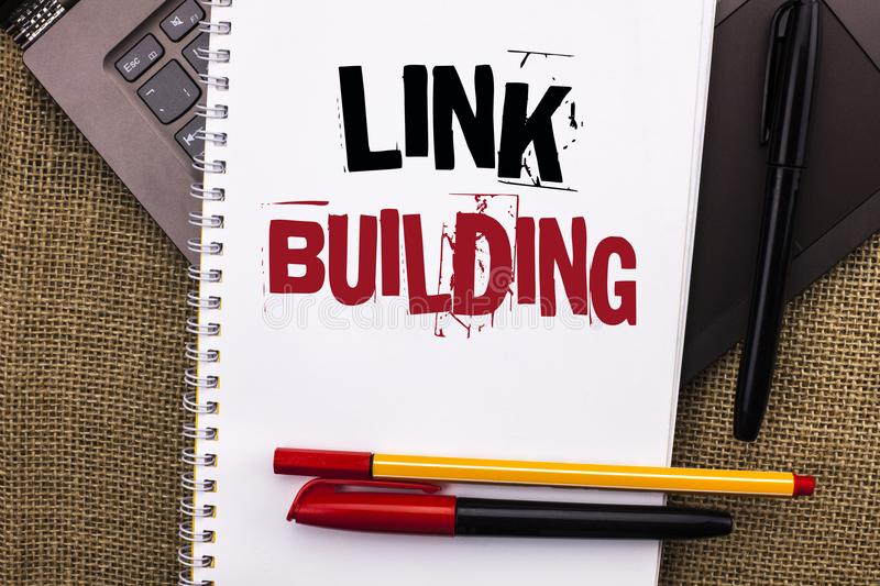 Writing note showing Link Building. Business photo showcasing Process of acquiring hyperlinks from other websites Connection writ. Ten Notebook Book placed royalty free stock photography