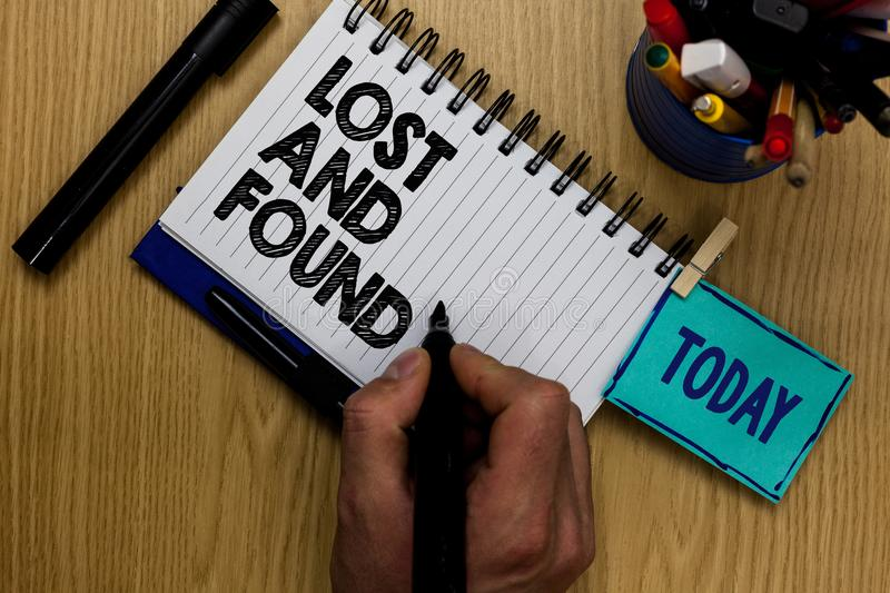 Writing note showing Lost And Found. Business photo showcasing Place where you can find forgotten things Search service Man holdin stock photo