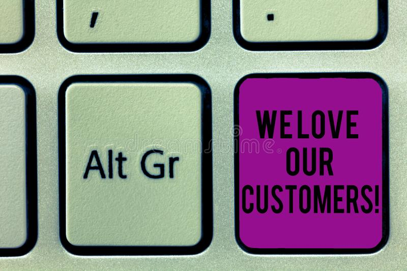 Writing note showing We Love Our Customers. Business photo showcasing Appreciation for clients good customer service. Keyboard key Intention to create computer stock photo