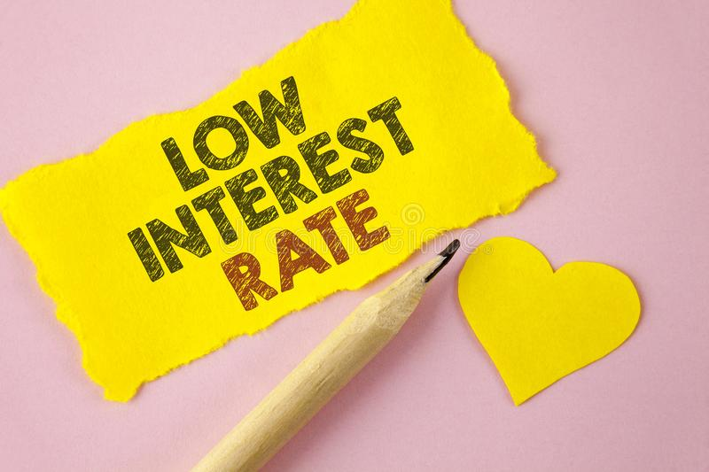 Writing note showing Low Interest Rate. Business photo showcasing Manage money wisely pay lesser rates save higher written on Tea. Writing note showing Low stock images