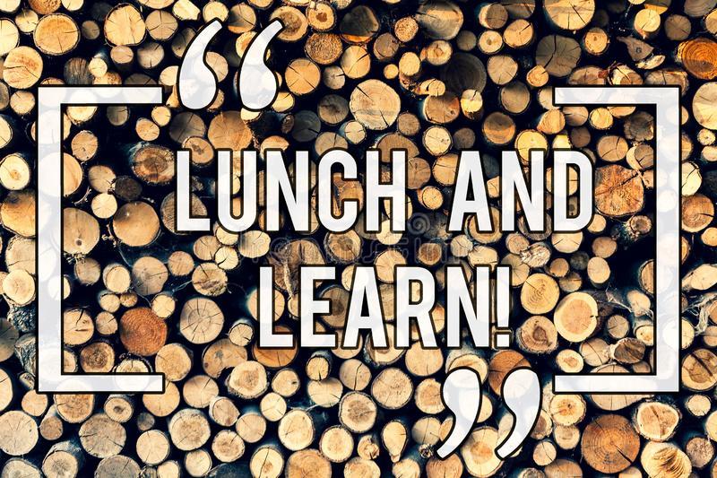 Writing note showing Lunch And Learn. Business photo showcasing Have meal and study motivation for education learning. Eating Wooden background vintage wood royalty free stock photography