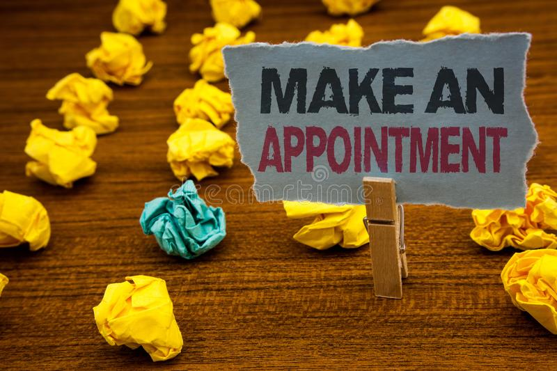 Writing note showing Make An Appointment. Business photo showcasing Schedule Arrangement Deadline Session Engagement Cardboard wi. Th letters wooden floor fuzzy royalty free stock photos