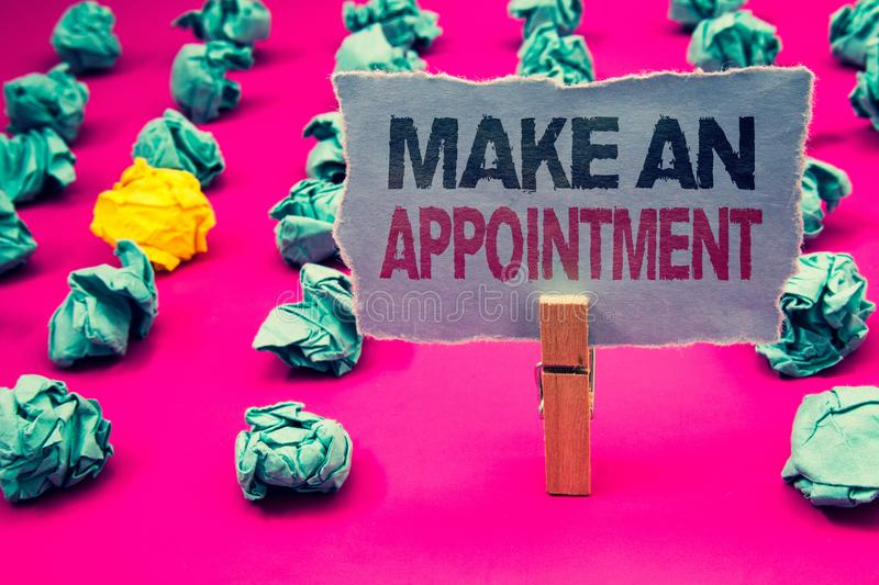Writing note showing Make An Appointment. Business photo showcasing Schedule Arrangement Deadline Session Engagement Emerald pape. R balls yellow lump rosy floor royalty free stock image