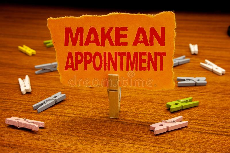 Writing note showing Make An Appointment. Business photo showcasing Schedule Arrangement Deadline Session Engagement Paperclip ho. Lding orange page show red stock photos