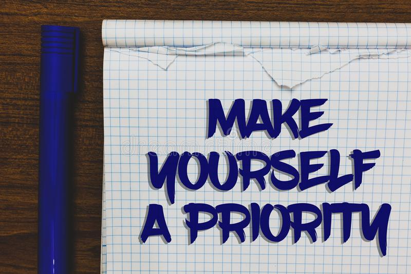 Writing note showing Make Yourself A Priority. Business photo showcasing Think in your own good first personal development Written. White notepad on grey wooden royalty free stock photography