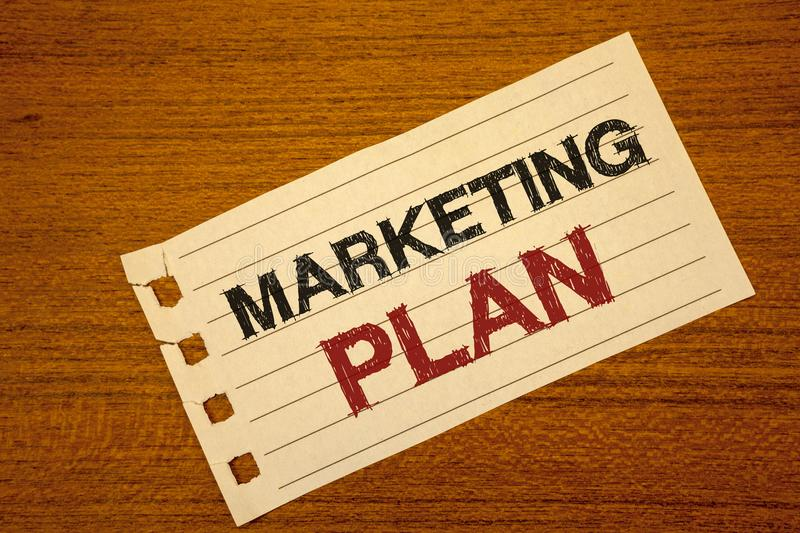 Writing note showing Marketing Plan. Business photo showcasing Business Advertising Strategies Market Successful Ideas Text two w. Ord white paper note wood desk royalty free stock images