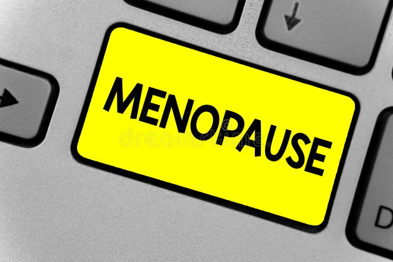 Writing note showing Menopause. Business photo showcasing Period of permanent cessation or end of menstruation cycle Keyboard yell stock photography