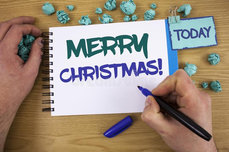 Writing note showing Merry Christmas Motivational Call. Business photo showcasing Holiday Season Celebration December Text two wo. Rds blue white notepad blue royalty free stock image
