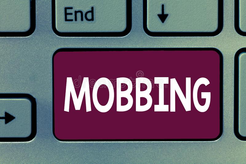 Writing note showing Mobbing. Business photo showcasing Bulling of individual specially at work Emotional abuse Stress royalty free stock photo