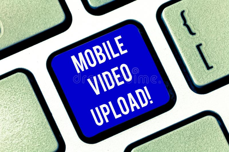 Writing note showing Mobile Video Upload. Business photo showcasing add videos on website or blog using cell phone. Keyboard key Intention to create computer stock images