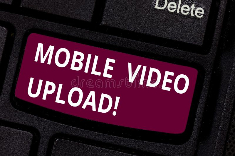 Writing note showing Mobile Video Upload. Business photo showcasing add videos on website or blog using cell phone. Keyboard key Intention to create computer stock photo