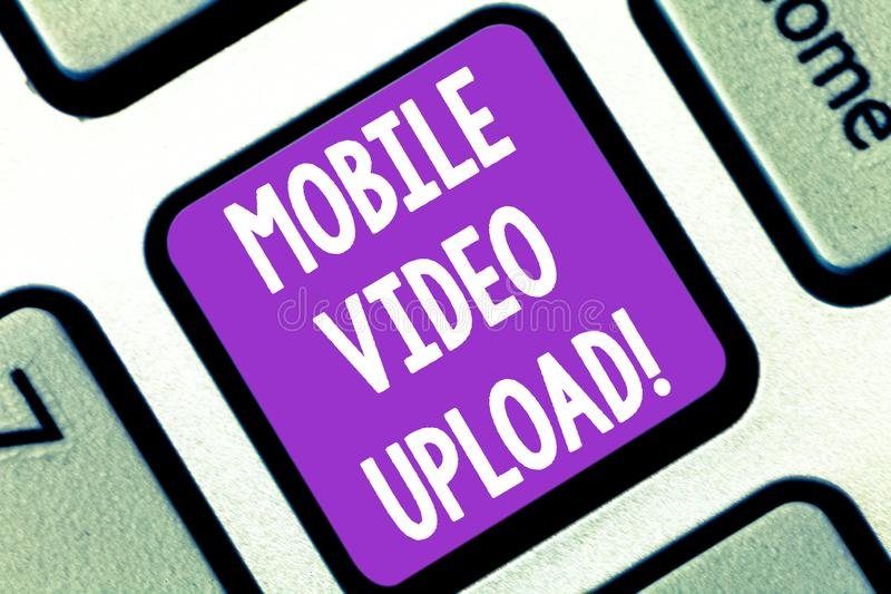 Writing note showing Mobile Video Upload. Business photo showcasing add videos on website or blog using cell phone. Keyboard key Intention to create computer royalty free stock image