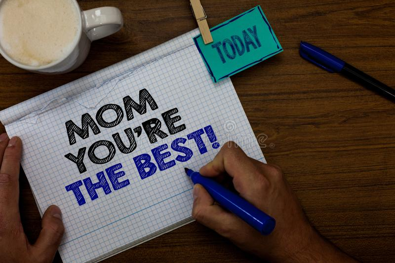 Writing note showing Mom You re are The Best. Business photo showcasing Appreciation for your mother love feelings compliment Hand royalty free stock images