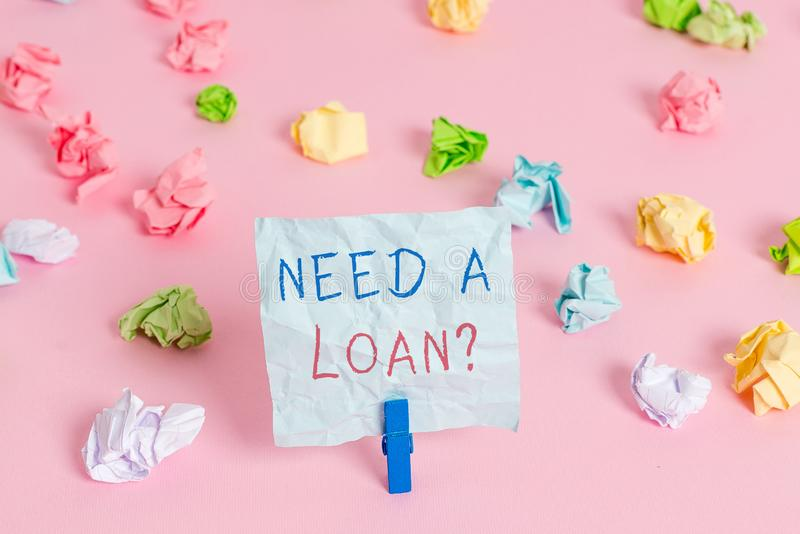 Writing note showing Need A Loan Question. Business photo showcasing asking he need money expected paid back with. Writing note showing Need A Loan Question stock photos