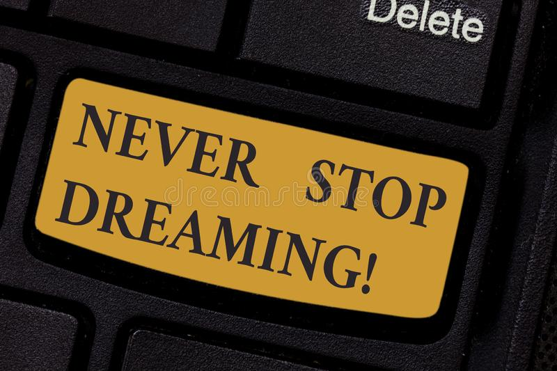 Writing note showing Never Stop Dreaming. Business photo showcasing dont waste your time in fantasy stick to achieve. Them Keyboard key Intention to create stock photo