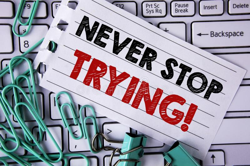 Writing note showing Never Stop Trying Motivational Call. Business photo showcasing go on do not give up Self confidence written. Tear Notepad paper placed royalty free stock image