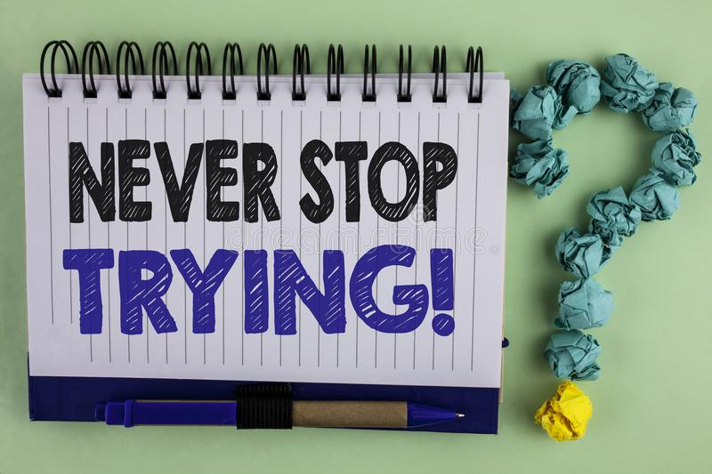 Writing note showing Never Stop Trying Motivational Call. Business photo showcasing go on do not give up Self confidence written. Notebook the plain background stock image