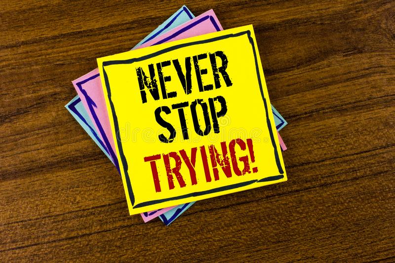Writing note showing Never Stop Trying Motivational Call. Business photo showcasing go on do not give up Self confidence written. Yellow Sticky Note Paper the royalty free stock images