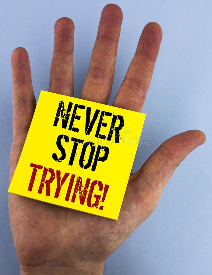 Writing note showing Never Stop Trying Motivational Call. Business photo showcasing go on do not give up Self confidence written. Sticky Note Paper the plain stock photography