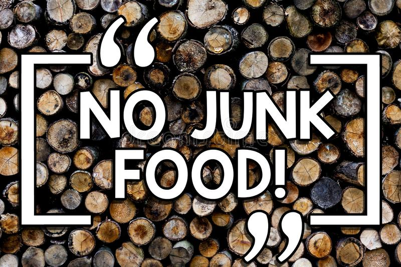 Writing note showing No Junk Food. Business photo showcasing Stop eating unhealthy things go on a diet give up burgers. Fries Wooden background vintage wood royalty free stock image