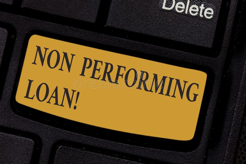 Writing note showing Non Performing Loan. Business photo showcasing in default stats within ninety days with no interest. Keyboard key Intention to create stock photo