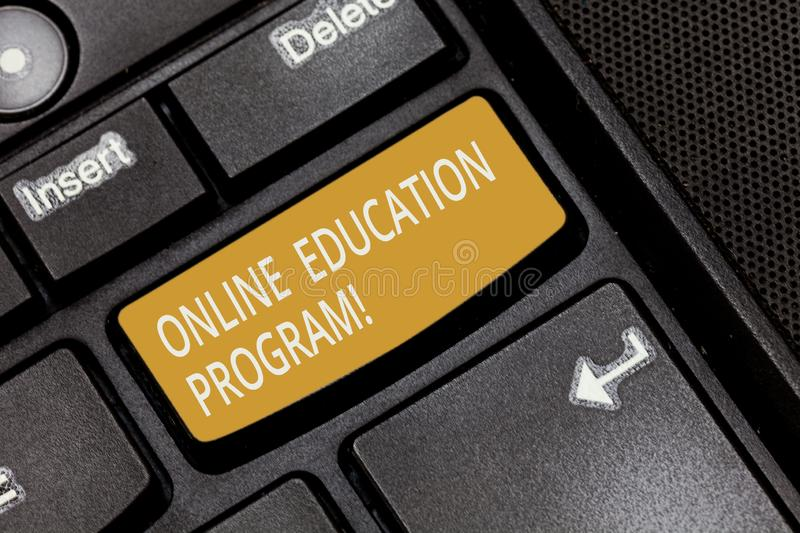 Writing note showing Online Education Program. Business photo showcasing Distance learning that relies on the Internet Keyboard. Key Intention to create royalty free stock images
