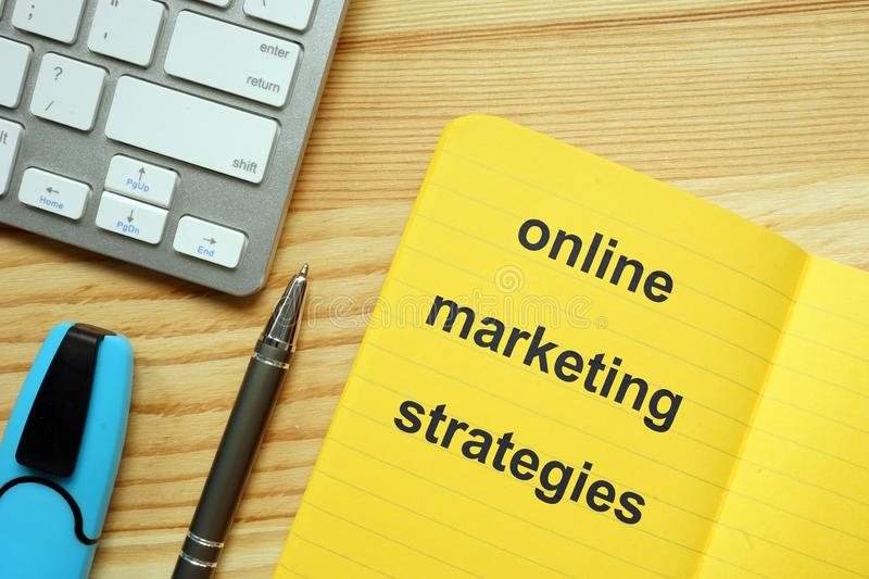 Writing note showing online marketing strategies. Business photo showcasing online marketing strategies. The text is written in royalty free stock photo