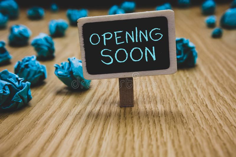 Writing note showing Opening Soon. Business photo showcasing Going to be available or accessible in public anytime shortly Blackbo stock photography