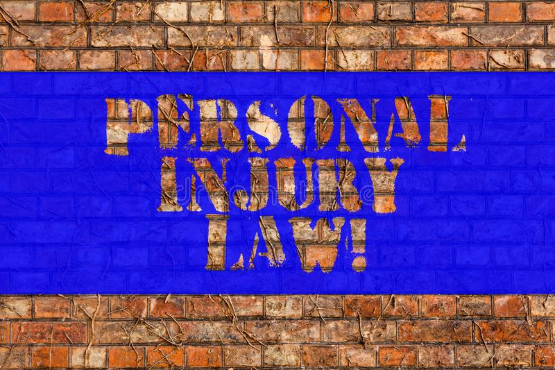Writing note showing Personal Injury Law. Business photo showcasing guarantee your rights in case of hazards or risks Brick Wall. Art like Graffiti motivational royalty free stock photography