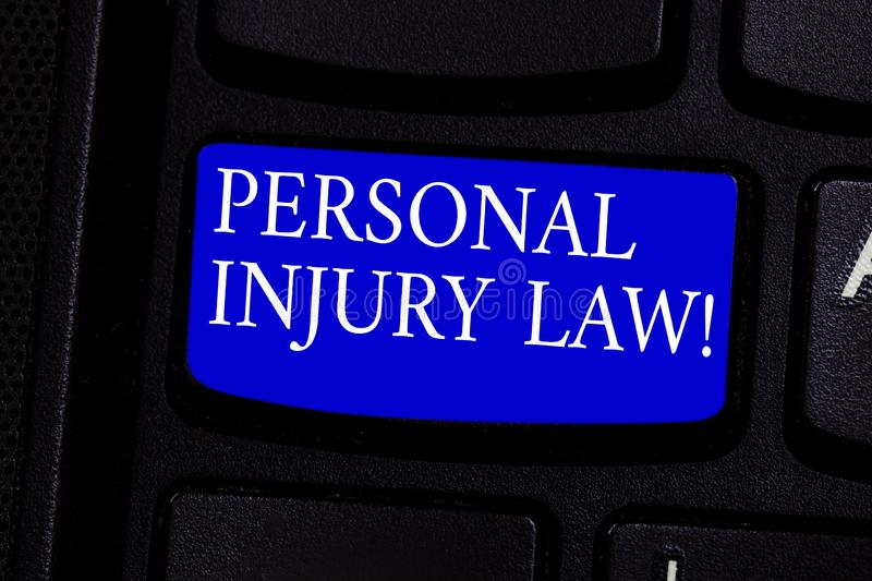 Writing note showing Personal Injury Law. Business photo showcasing guarantee your rights in case of hazards or risks Keyboard key. Intention to create computer stock photography