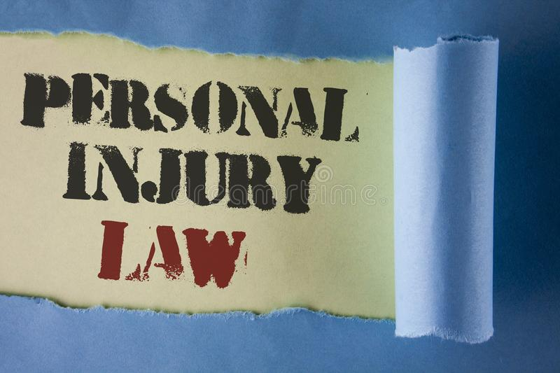 Writing note showing Personal Injury Law. Business photo showcasing guarantee your rights in case of hazards or risks written und. Er Tear Folded paper plain stock images