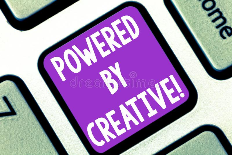 Writing note showing Powered By Creative. Business photo showcasing characterized by originality of thought or. Inventiveness Keyboard key Intention to create royalty free stock image