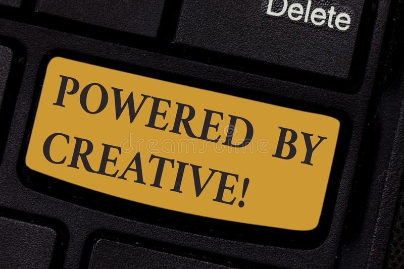 Writing note showing Powered By Creative. Business photo showcasing characterized by originality of thought or. Inventiveness Keyboard key Intention to create royalty free stock photos